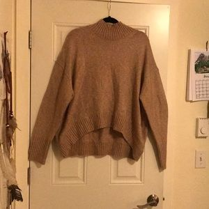 Tan turtleneck sweater